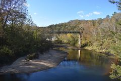 Iron bridge on a river in Oklahoma. This image was taken in Southern Oklahoma. Just driving around in places i haven`t been Stock Image