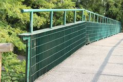 Iron bridge and road asphalt Royalty Free Stock Photography