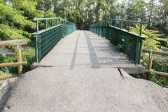 Iron bridge and road asphalt Stock Photography