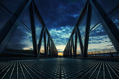 Iron Bridge. At sunset orange clouds Royalty Free Stock Photos