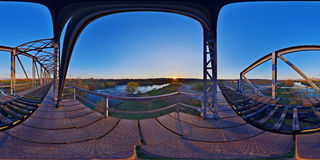 Iron Bridge at Sunset. 360 panorama of a disused iron railway bridge across the Mureș River at sunset on the outskirts of Târgu Mureș, Romania Stock Photo