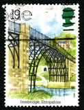Iron Bridge UK Postage Stamp. UNITED KINGDOM - CIRCA 1989: A used postage stamp from the UK, depicting an illustration of the historic Shropshire landmark - the stock images