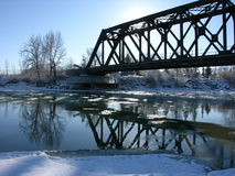 Iron bridge in winter. An old iron bridge over a river in winter Royalty Free Stock Photos