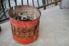 The iron bucket burning paper money Royalty Free Stock Photography
