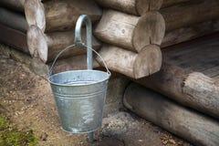 Iron bucket on a hook Stock Photos