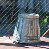 Iron bucket. Macro detail of iron bucket Royalty Free Stock Photos