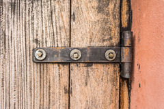 Iron butt hinges door. With old wood pattern Royalty Free Stock Photo