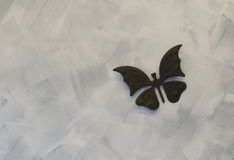 Iron butterflys on cement background Stock Image