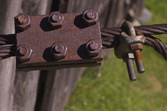 Iron cable and rusty bolt. Rusty bolt and iron cable stock images