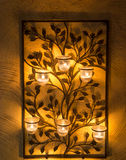 Iron Candle holder on wall Stock Photography