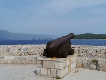 An iron cannon to defend Korcula city Stock Photos