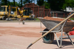 Iron cart full of sand on a construction site. Photo was taken on a nice sunny day. Time: about noon. Photo was taken on a construction site near football Royalty Free Stock Images