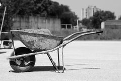 Iron cart full of sand on a construction site. Photo was taken on a nice sunny day. Time: about noon. Photo was taken on a construction site near football royalty free stock photo