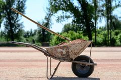 Iron cart full of sand on a construction site. Photo was taken on a nice sunny day. Time: about noon. Photo was taken on a construction site near football royalty free stock photography