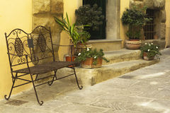 Iron cast bench on a street from Tuscany Stock Photo