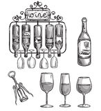 Iron cast wine holder, bottles and glasses. Royalty Free Stock Image