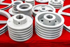 Iron casting industrial parts pulley for transmission power to automotive engine pump or blower casting by green sand or shell stock photography