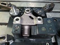 Iron casting part clamp by jig. Fixture on  CNC machining center Royalty Free Stock Photos