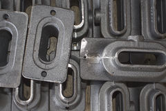 Iron casting parts. For construction lay in stock area Royalty Free Stock Photos