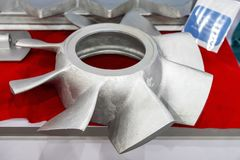Iron casting parts vane propeller blade of pump or blower casting by green sand or shell mold process on red table.  stock image