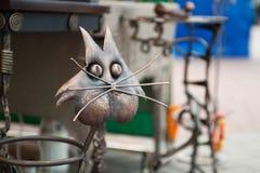 Iron cat head, metal animal, creative metal work stock photography