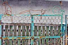 Iron cats from wire on a fence stock photo