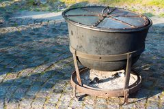 Iron cauldron with a fire chamber for cooking Stock Images