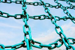 Iron chain. The iron chain of  fitness equipment with a blue sky background in a park Royalty Free Stock Image
