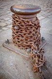 Iron chain and anchoring post Stock Images