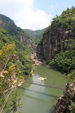 Iron chain bridge in ravine Royalty Free Stock Image