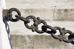 Iron chain links. In front of a concrete wall stock photo