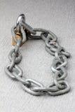 Iron chain lock key on rock Royalty Free Stock Photo