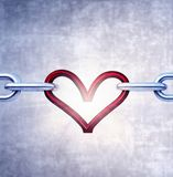 Iron chain with red heart as the one the links royalty free stock image