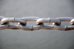 Iron chain and river background Royalty Free Stock Image
