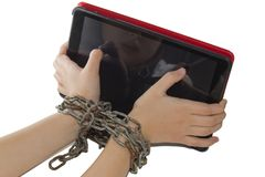 Iron chain ties together hands and smartphone - mobile phone addiction concept. Iron chain ties together hands and smartphone - mobile phone addiction concept Royalty Free Stock Images