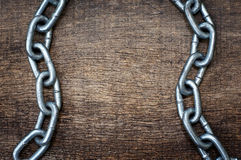 Iron chain on  wooden Royalty Free Stock Photos