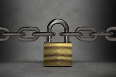 Iron chains connected to a golden padlock Stock Images