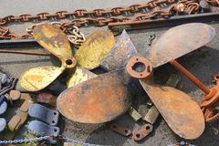 Iron chains and ships propellers. Iron chains and steel propellers on the dockside at the Port of Bristol in England royalty free stock photo