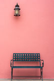 Iron chair in front of wall Stock Images