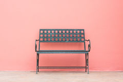 Iron chair in front of wall Royalty Free Stock Images