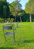 Iron chair and table in a beautiful green garden Royalty Free Stock Photography