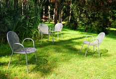 Iron chairs in the garden. Backyard furniture. A four iron chairs in the garden Royalty Free Stock Photography
