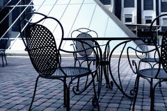 Iron chairs in a summer cafe royalty free stock images