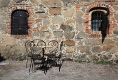 Iron chairs and table in traditional backyard Royalty Free Stock Photography