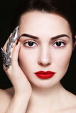 Iron claw. Portrait of ypung beautiful woman with stylish make-up and claw ring on her finger stock photo