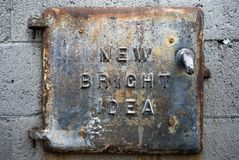 An iron coal hatch door on a brick exterior stock image