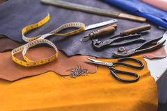 Iron cobbler tools on leather Royalty Free Stock Images