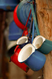 Iron coffee pot. Hanging colored iron coffee pots Royalty Free Stock Images