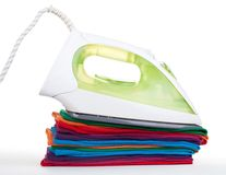 Iron on colorful clothes Royalty Free Stock Image