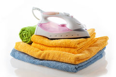 Iron on colorful towels Stock Photos